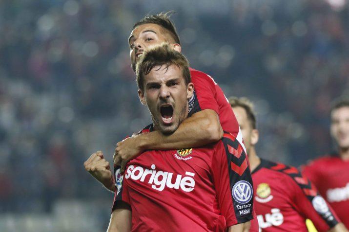 Muñiz i Giner celebren el primer gol grana. Foto: Nàstic