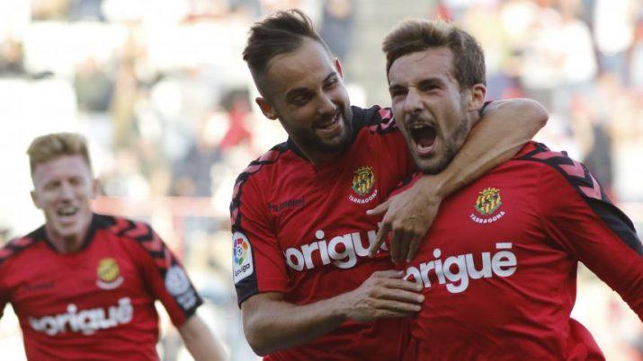 Giner i Muñiz celebren el gol de l'asturià. Foto: Nàstic